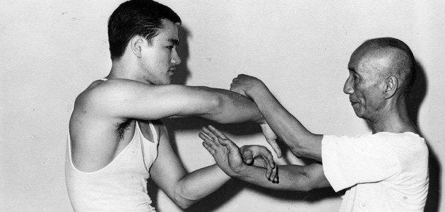 Bruce Lee sparring with Ip Man, ca 1955.